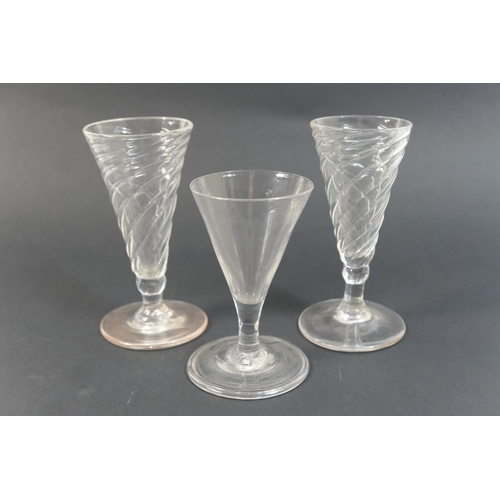 15 - Pair of George III wrythen dwarf ale glasses, 12.5cm; also a further dwarf ale glass with folded foo...