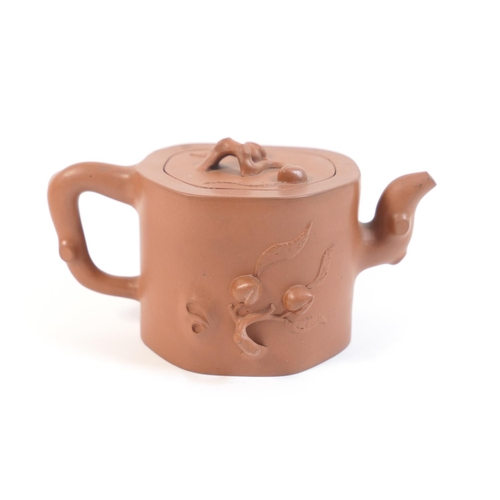 26 - Yixing teapot, 20th Century, traditional form worked with peaches, impressed marks, height 10cm...