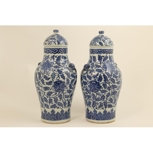27 - Pair Chinese blue and white lidded vases in Ming style, 18th Century, each having a domed cover with...