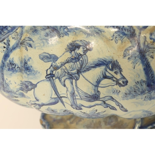 28 - Impressive and large Savona blue and white maiolica table centre, 19th Century, boat shape with mask...