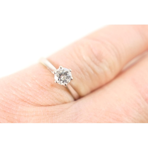 371 - Diamond solitaire ring, the brilliant cut stone of approx. 0.4ct, set in an 18ct white gold six claw...
