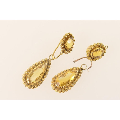 409 - Pair of Victorian 18ct gold and citrine pendant earrings (with damages), having a tear shaped pendan...