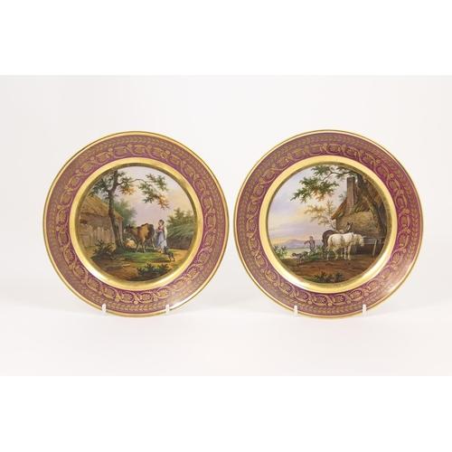 46 - Pair of Paris porcelain plates, decorated by Jean-Pierre Feuillet (1776-1840), circa 1830, each depi...