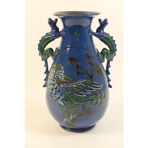 4 - Brannam Barum vase, attributed to James Dewdney, baluster form with dragon handles at the neck, inci...