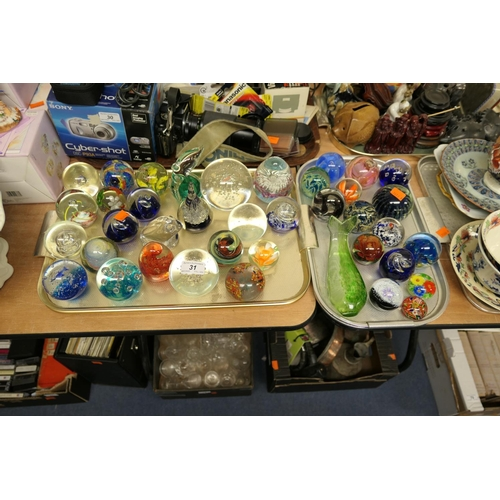 31 - Collection of glass paperweights including Mdina, Caithness and others (2 trays)...