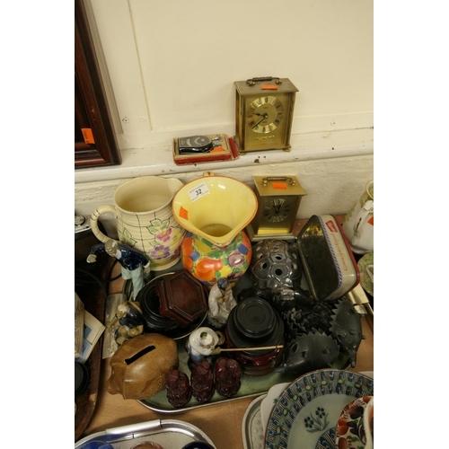 32 - Oriental figural ornaments, stands, two Art Deco jugs, two mantel clocks etc...