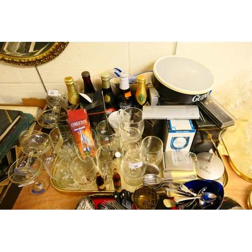 26 - Guinness memorabilia including glasses, bottles, pen sets, miniatures; also six Babycham wine coupes...