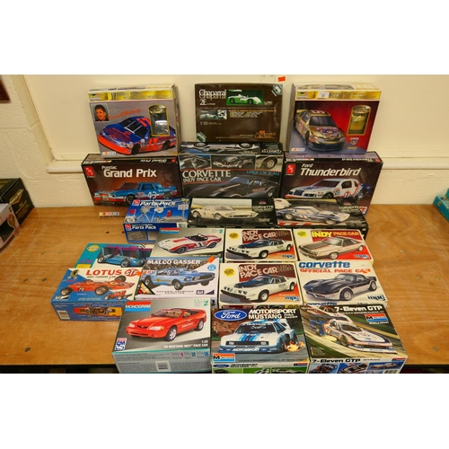 23 - A sizeable amount of mixed manufacturers car model kits of Nascar and Indycar vehicles etc (20) (Ple...