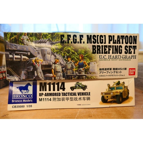 34 - Two military model kits of a Bronco M1114 upper armoured tactical vehicle and a Bandai EFGF platoon ...