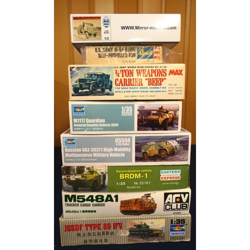 45 - Various model kits of military vehicles including a tracked cargo carrier, armoured security vehicle...