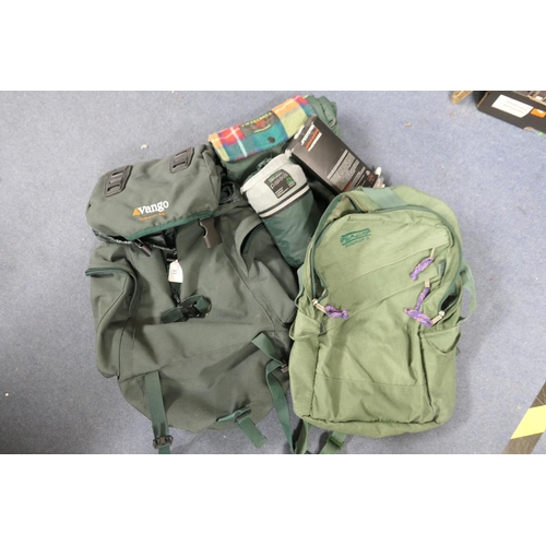 23 - Vango Canyon 25 rucksack, a smaller Blacks rucksack, Tweedmill wrap-around thermal blanket and a Cra...