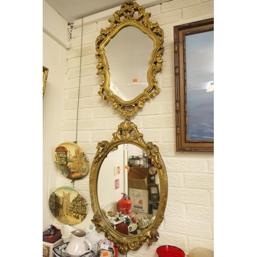 3 - Two ornate gilt framed mirrors, one with four cherubs set around the edge...