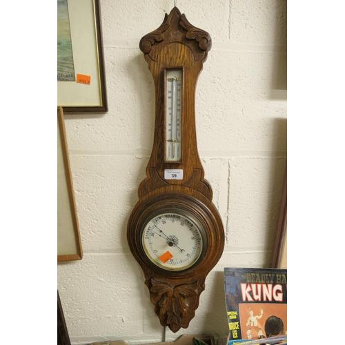 39 - Carved oak barometer...