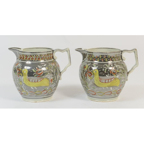 10 - Two similar Staffordshire silver resist milk jugs, circa 1820, baluster form, each decorated with a ...