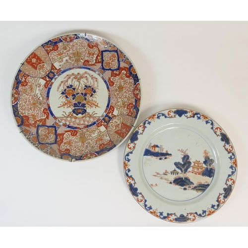 14 - Chinese Imari plate, late 18th Century, decorated with a river landscape in underglaze blue, terraco...