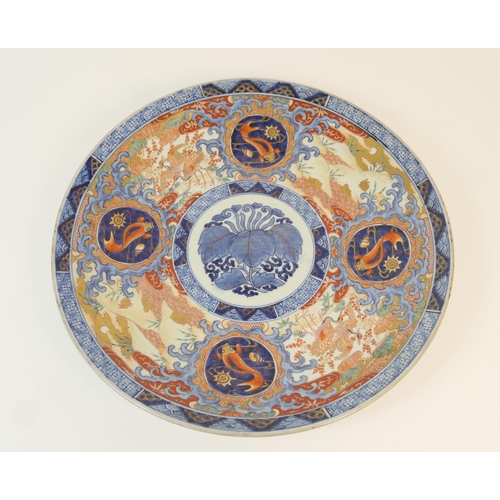 17 - Japanese Imari charger, Meiji(1868-1912), centred with leaves and with goldfish roundels, in undergl...