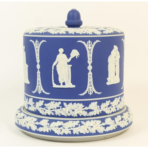 19 - Dark blue jasperware cheese bell on stand, with acorn finial and acorn trails bordering a band of cl...