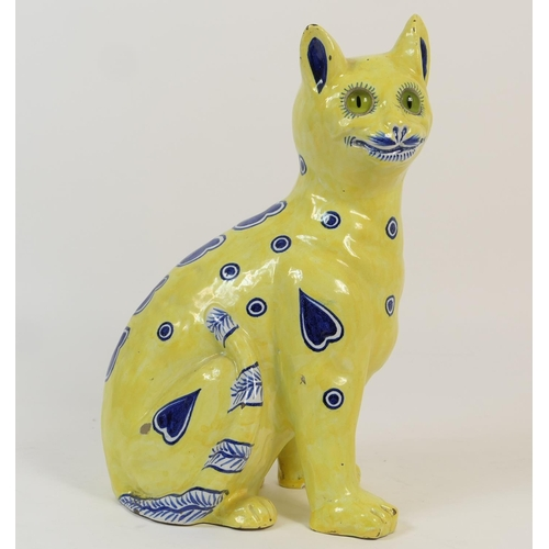 25 - French faience pottery cat in the style of Gallé, having an allover yellow glaze punctuated with blu...