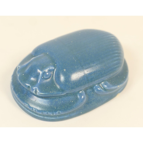 27 - Pilkingtons Lancastrian scarab beetle paperweight, decorated in an allover matte blue glaze, impress...