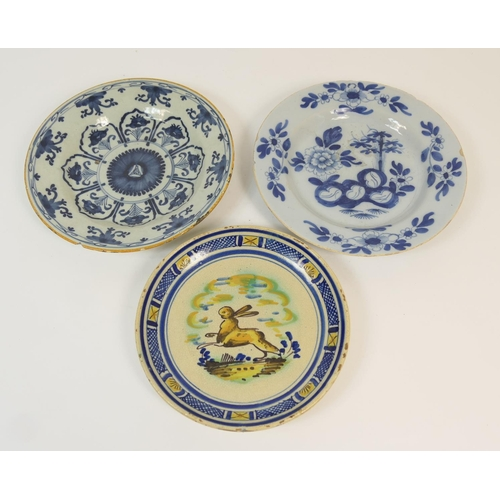 36 - Two Dutch delft blue and white plates, late 18th Century, one decorated with a peony rock pattern, 2...
