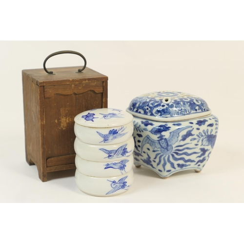 41 - Japanese blue and white porcelain stacking dishes, early 20th Century, decorated with flying cranes ...
