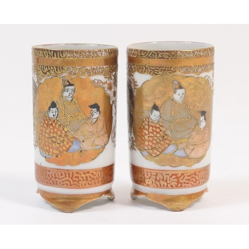 42 - Pair of miniature Japanese Kutani cylinder vases, each decorated with Immortals in gilt and terracot...