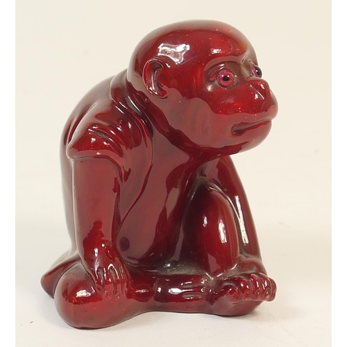 48 - Bernard Moore flambe monkey, modelled seated and with original glass eyes, impressed mark 'Moore', h...