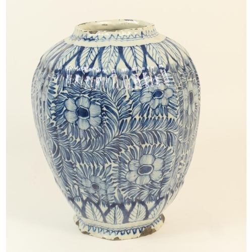 33 - Dutch delft blue and white octagonal blue and white jar, 18th Century, decorated with flowerheads an...