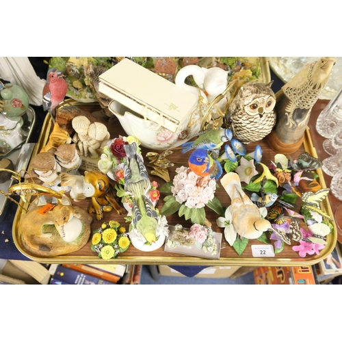 22 - Collectors' ornaments comprising butterflies, birds etc, also a carved horn figure of an eagle...