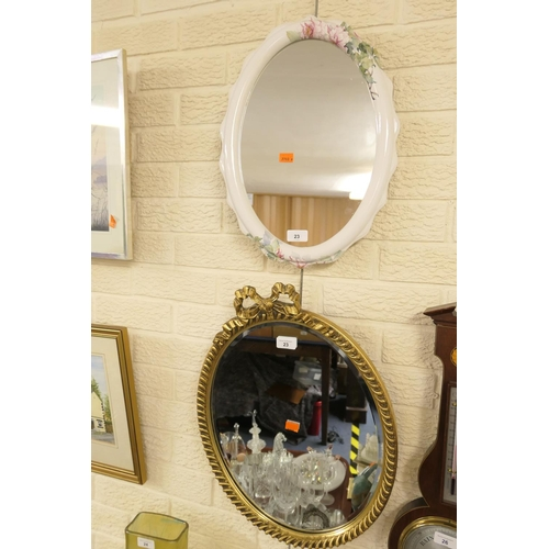 23 - Oval wrythen edged gilt framed mirror and another mirror (2)...