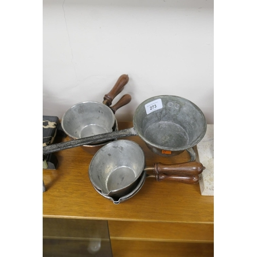 273 - Six small copper pouring pans and a further pan with wrought legs and handle (7)...