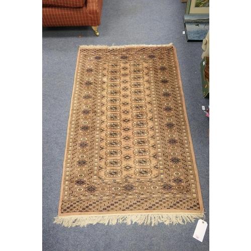 568 - Bokhara fawn ground rug, size 155 x 100cm...