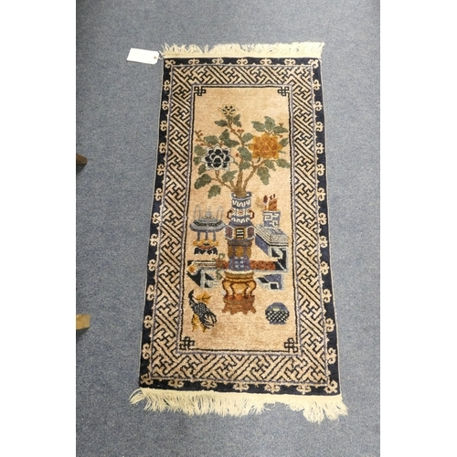 587 - Chinese silk pictorial rug, size 123 x 61cm...