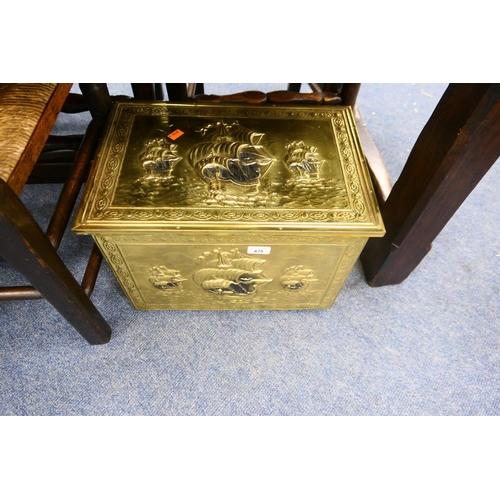 675 - Embossed brass slipper box...
