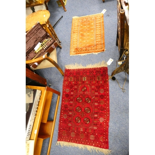 662 - Turkman red ground prayer rug, size 117 x 78cm, and a small bokhara terracotta ground rug, size 90 x...