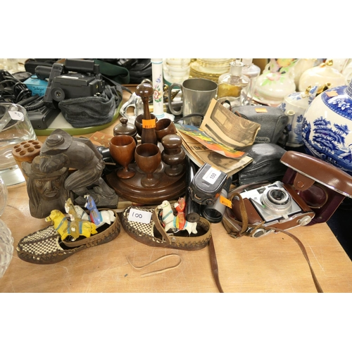 100 - Treen egg cruet, other treen items and vintage cameras...