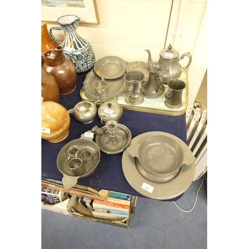 93 - Assorted 19th Century and later pewter wares including plates, porringers, teapot, jugs, chamberstic...