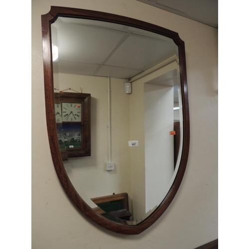 687 - Victorian satin walnut and inlaid shield shaped mirror...