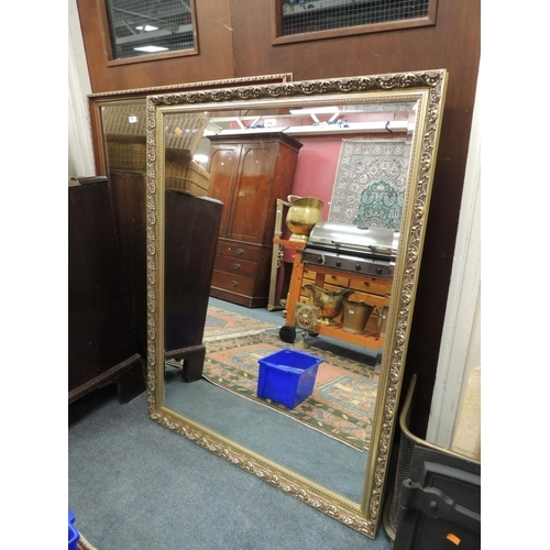 712 - Two large modern gilt framed bevelled glass wall mirrors...