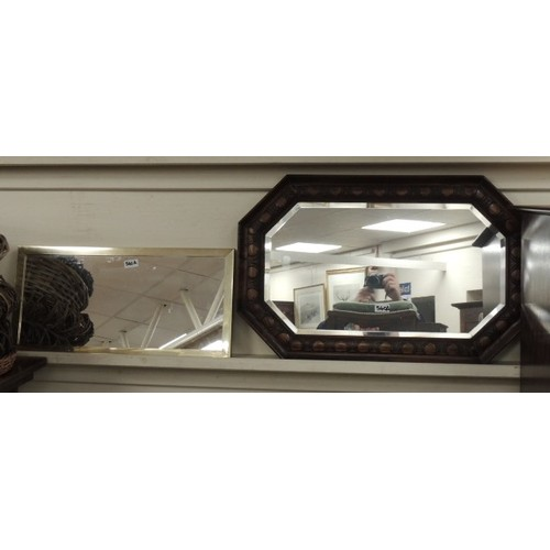 540A - Carved oak framed octagonal bevelled glass wall mirror and a further wall mirror (2)...