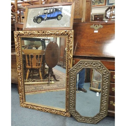 709 - Victorian embossed brass octagonal wall mirror a Rolls Royce mirror and a Moulded gilt framed wall m...