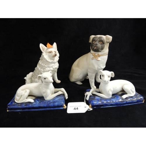 44 - Continental bisque porcelain model of a pug dog, further porcelain model of a dog and a pair of porc...