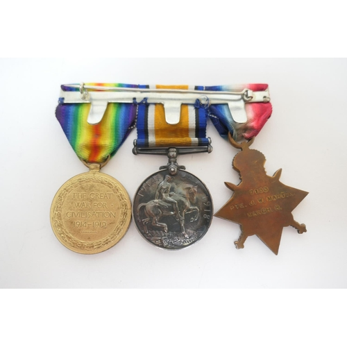 581 - Great War medal group of three, awarded to 7133 Pte. J.W. Martin. Manch R. comprising 1914-15 Star, ...