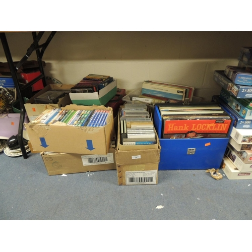 38 - Mixed collection of LPs, CDs, DVDs and cassettes etc (9 boxes)