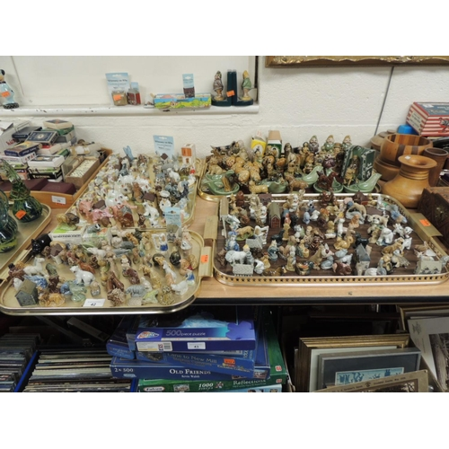 42 - Good collection of Wade Whimsical figures; also several Whimsie-On-Why houses and several Shamrock P...
