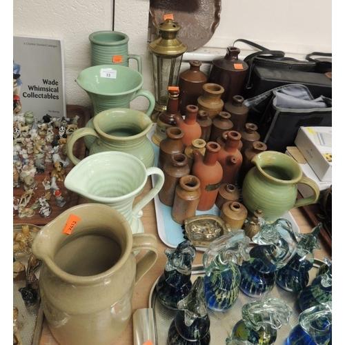 33 - Six stoneware water jugs; also stoneware bottles, copper dust tray, brass lamp etc