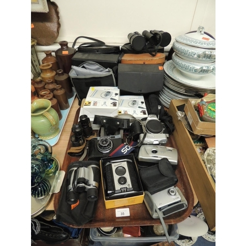 35 - Mix of binoculars and cameras including a Canon EOS 500 body, Brownie Reflex, boxed; also cased and ...