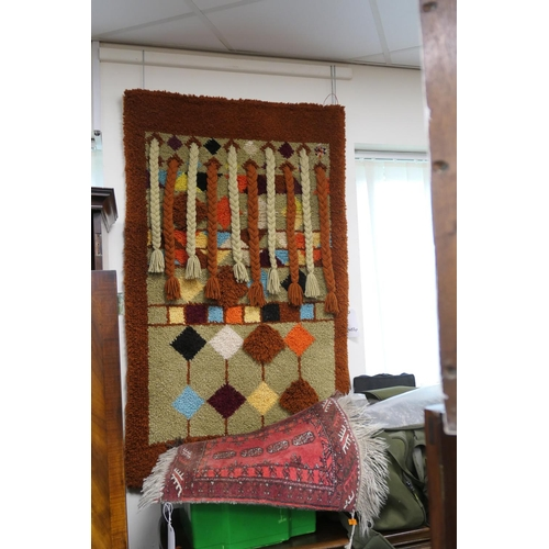 621 - Small red ground bokhara rug and an unusual tufted wall rug (2)