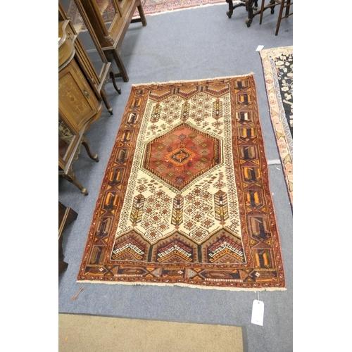 796 - Hamadan brown ground woollen rug, size 209cm x 137cm