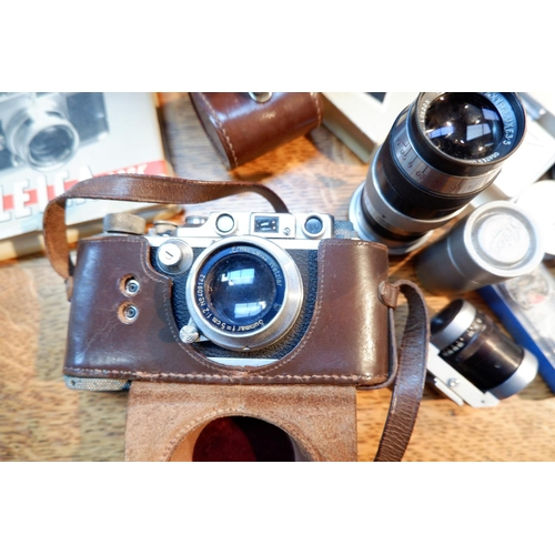 498 - A LEICA III camera No 328058 with Summar 50mm 1.2 lens No 409142 in E.R. leather case, a LEITZ ELMAR...